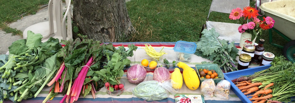 photo: table displaying fresh produce and flowers