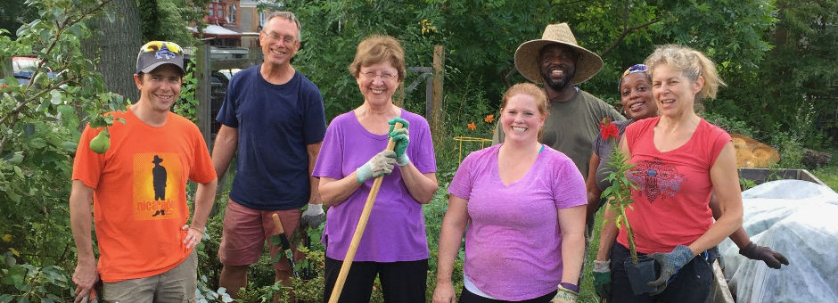 photo: group of gardeners posing with tools