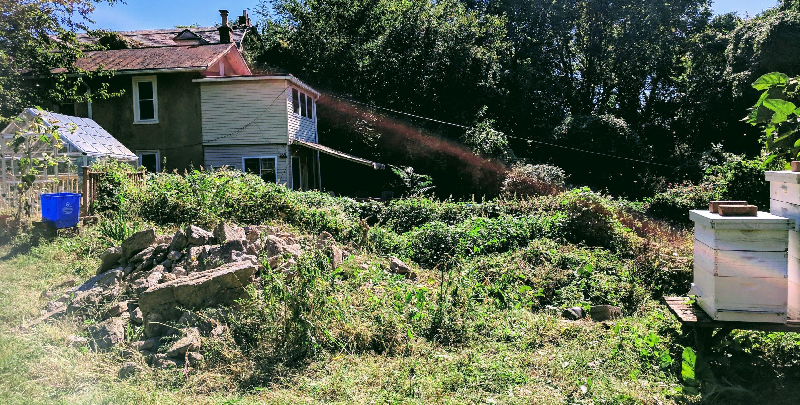photo of pile of stones beside grassy area in garden