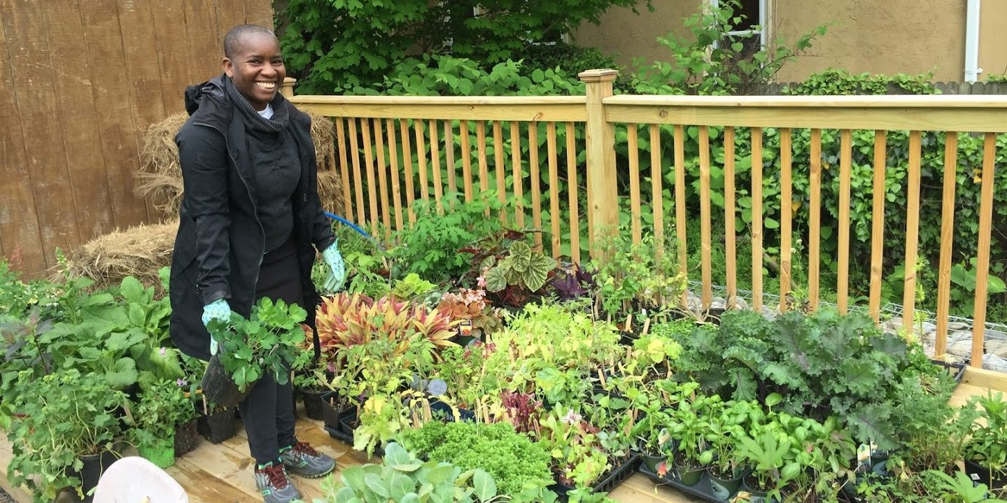 photo: smiling woman with hundreds of plants