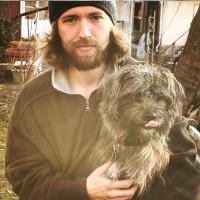 photo: man holding small dog